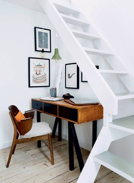 make your staircase as airy as you can to let some light inside and add hanging lamps over the working space