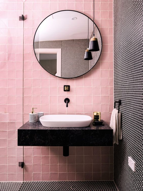 pink and black penny tiles create a bold and chic combo for a modenr bathroom