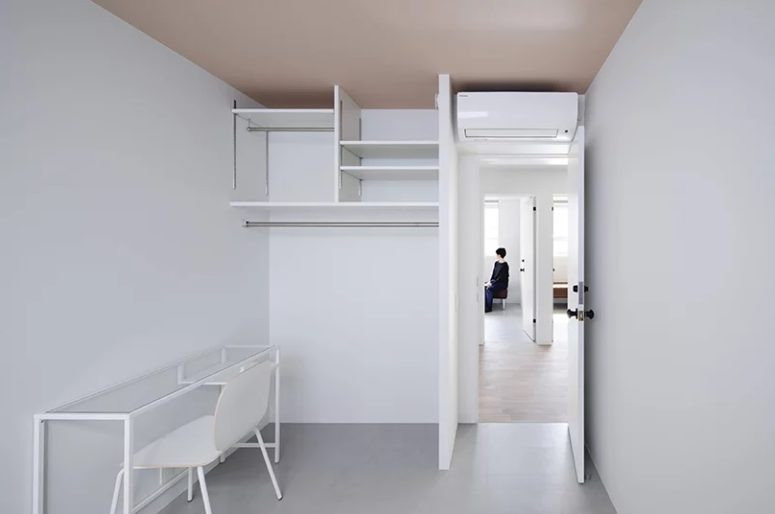 Here's one more working space done in all-white, with white furniture and an open storage unit