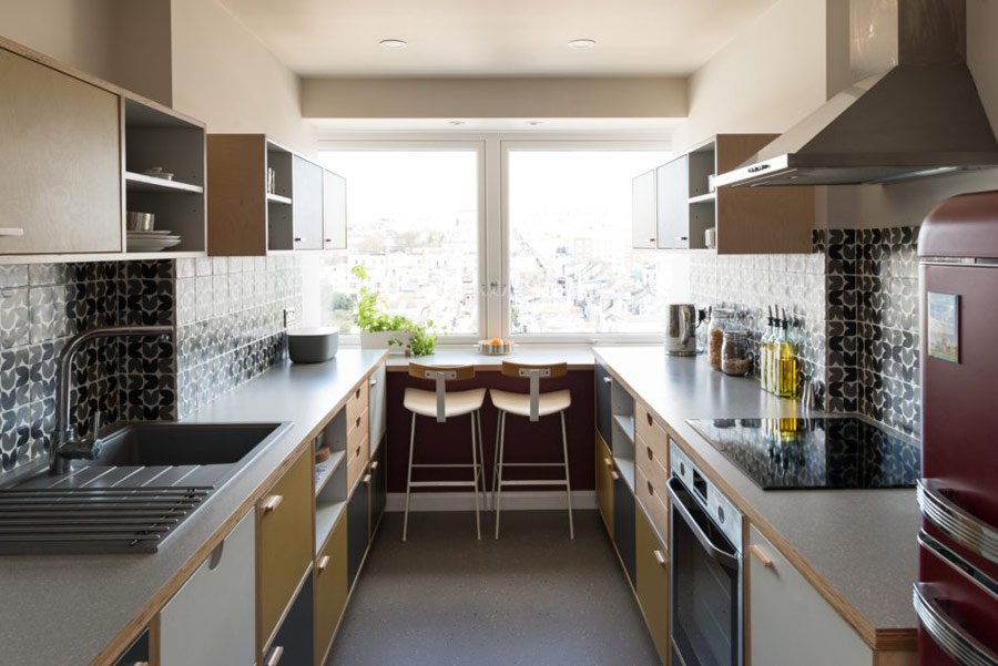 kitchen with tiles on a backsplash