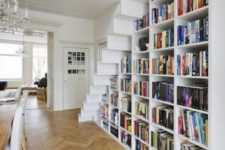 10 a large bookcase built under the stairs is all you need to save the space and acomodate them all