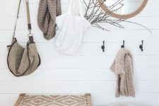 10 a wooden rack, a rope mirror, a basket for storage, a woven bench for a serene boho look