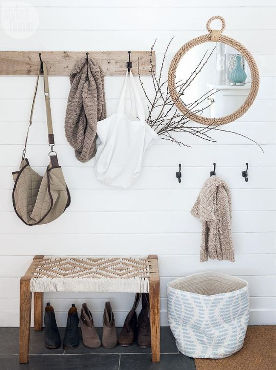 a wooden rack, a rope mirror, a basket for storage, a woven bench for a serene boho look