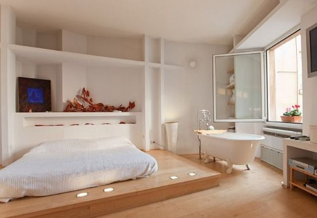 an airy Japandi bedroom with a free standing bathtub by the window to enjoy the views