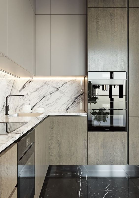 an elegant modern two-toned kitchen with a black and white marble backsplash and countertop for a refined feel