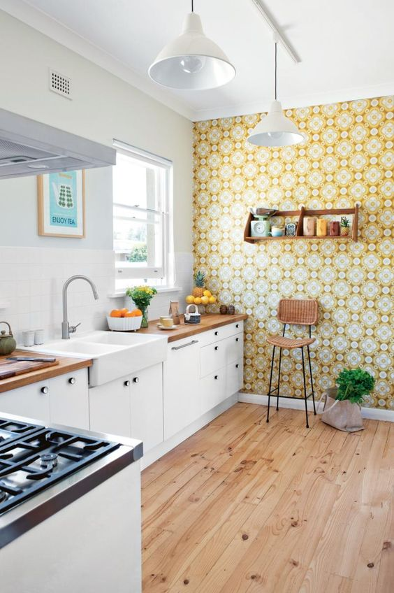 bold yellow printed wallpaper brings a sunlit feel and a bit of retro style to the kitchen