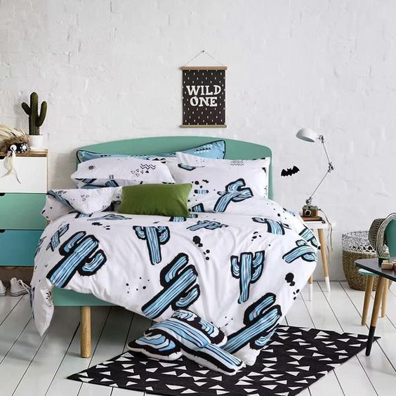 fun blue cactus print bedding for a modern space, would also be fine for a teenage bedroom