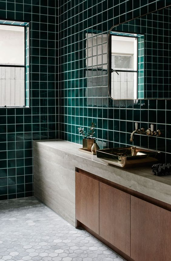 glossy dark green tiles, stone, marble tiles and wood create a fantastic combo for a stylish bathroom look