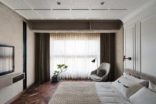 12 The master bedroom is a very cozy and neutral space with upholstered furniture
