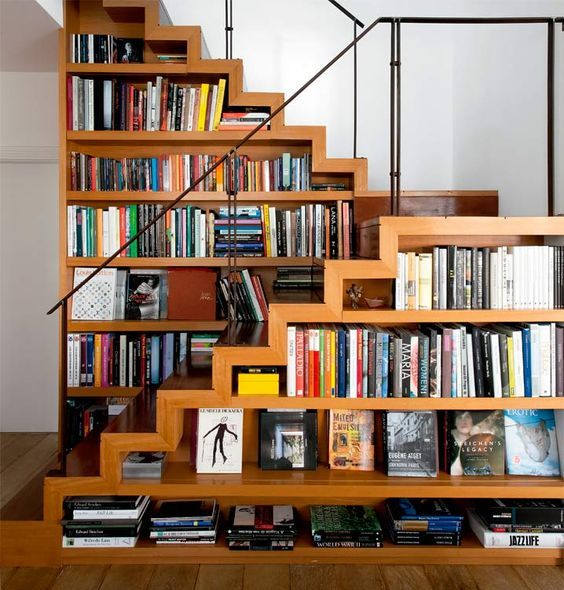 a creative staircase with bookshelves integrated right into it - a great space-saving idea