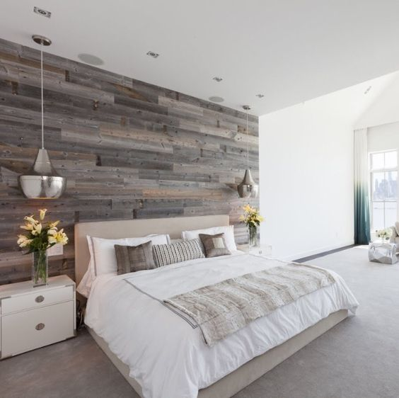 a reclaimed wood accent wall to add a cozy rustic touch to the bedroom