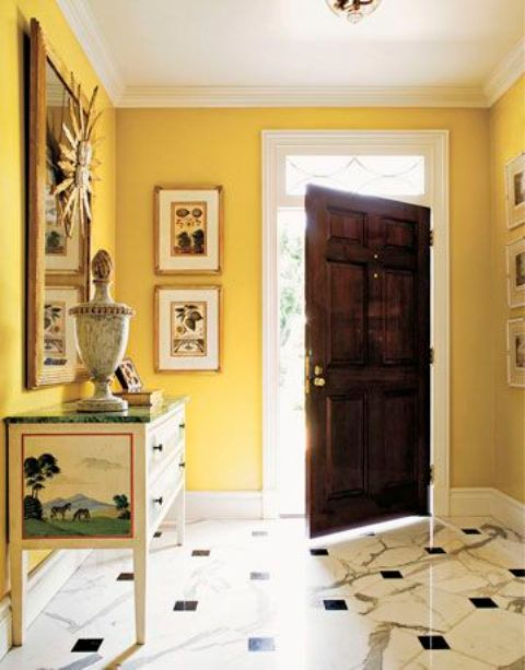 an yellow entryway seems to be filled with sunshine and looks bright, while yellow expands it