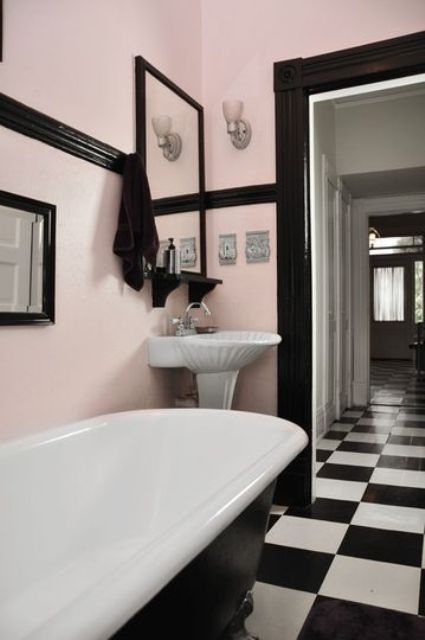 pink walls, black detailing and black and white checked floors create a chic vintage space