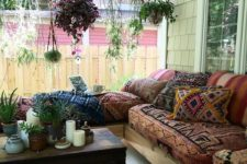 13 a boho gypsy porch with a wooden chest as a side table, a whole hanging garden and a corner sofa with printed upholstery