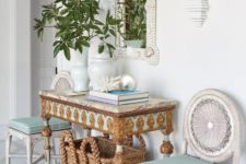 13 a whimsy and luxurious beach entryway with aqua touches, a basket for storage, white woven chairs, an encrysted console and a shell clad mirror
