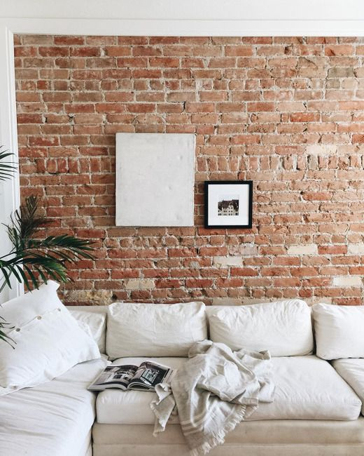 add coziness and texture to your living room making a brick accent wall or highlighting an existing one