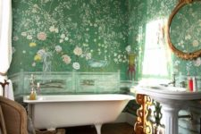 13 green floral wallpaper covering the walls creates a chic and stylish look with a vintage feel