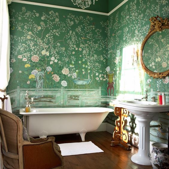 green floral wallpaper covering the walls creates a chic and stylish look with a vintage feel