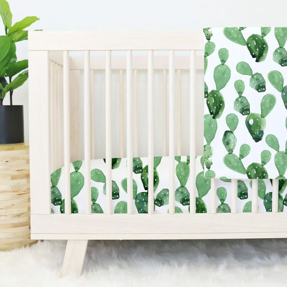 make your nursery sweeter and boho-like with fun watercolor cactus print bedding like this