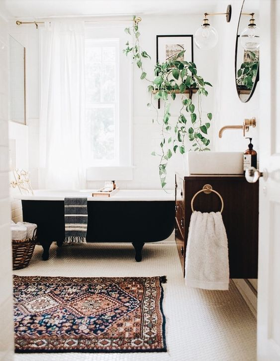 make your space boho with potted plants, a printed rug and some baskets