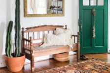 14 a boho rug, a vintage wooden bench, cacti and a mirror ina  gilded frame