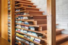 14 a modern take on a traditional staircase with two-sided steps and lots of book stored there