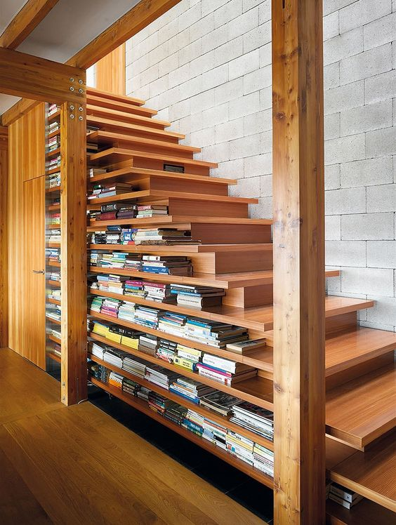 a modern take on a traditional staircase with two-sided steps and lots of book stored there