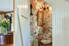 14 floral wallpaper is a trend for bathroom decor, and here it's rocked right with a vintage bowl sink and wooden furniture