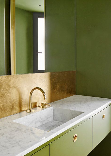 grass green walls and drawers plus a polished metal backsplash for a chic contrasting look