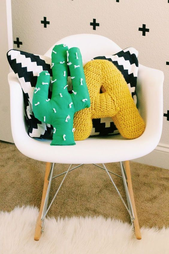 a bold green cactus pillow is a simple way to spruce up the space and you can DIY it