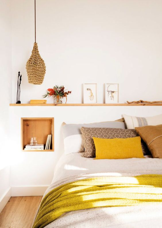 a neutral bedroom infused with light-colored wood, wicker and bright yellow touches
