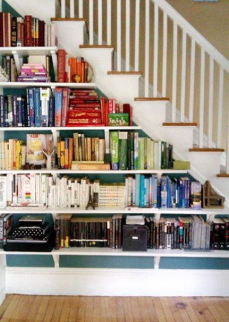 a staircase with built-in bookshelves, which look rather airy due to being open ones