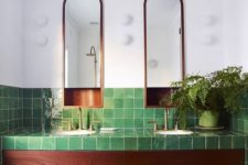 15 glossy green tiles with a texture and rich wood plus potted greenery for a luxurious and relaxing space