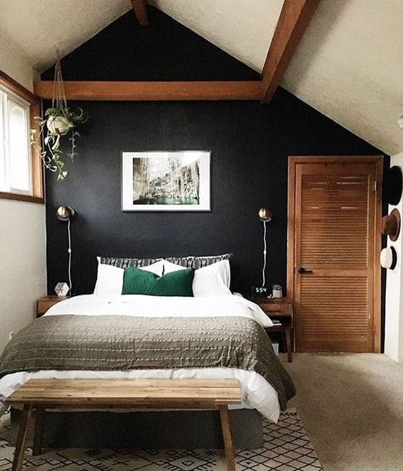 sometimes a painted black wall is what brings comfort and relaxation to your bedroom