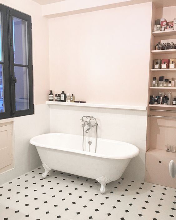 very light pink walls and a mosaic tile floor create a refined and modern look