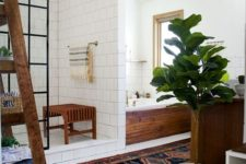 16 a boho chic space with white tiles, potted greenery, wooden touches and a boho rug