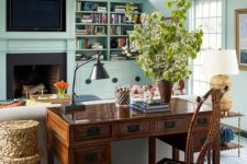16 a vintage meets rustic living room with a gorgeous stained wooden desk and a matching chair behind the sofa