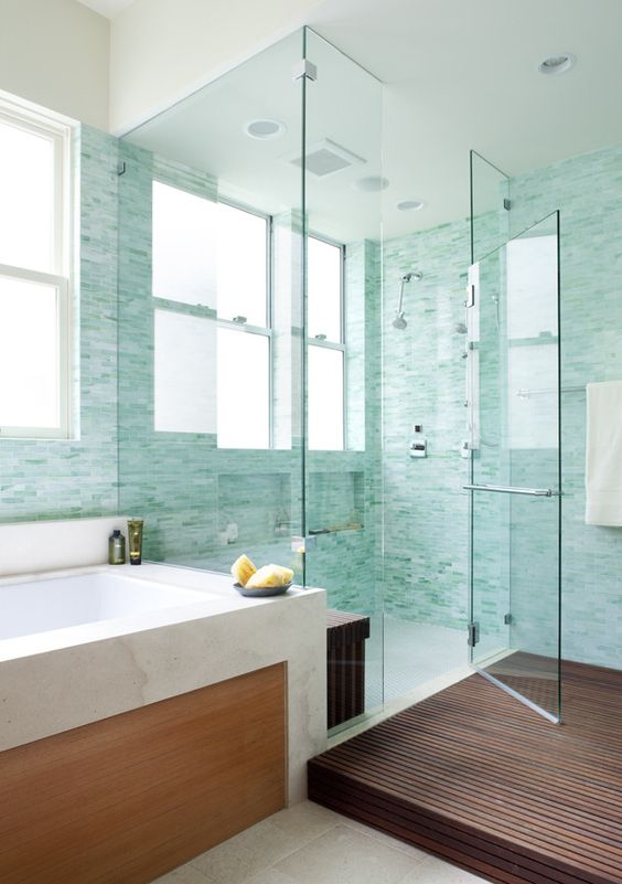 gorgeous turquoise little tiles in the lighter and bolder shades to create a watercolor feel in the bathroom