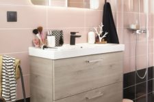 16 large scale pink tiles and black ones on the floor for a catchy look and light-colored wood for warmth