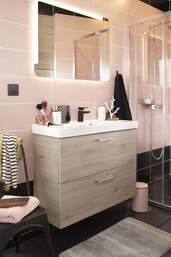 large scale pink tiles and black ones on the floor for a catchy look and light-colored wood for warmth