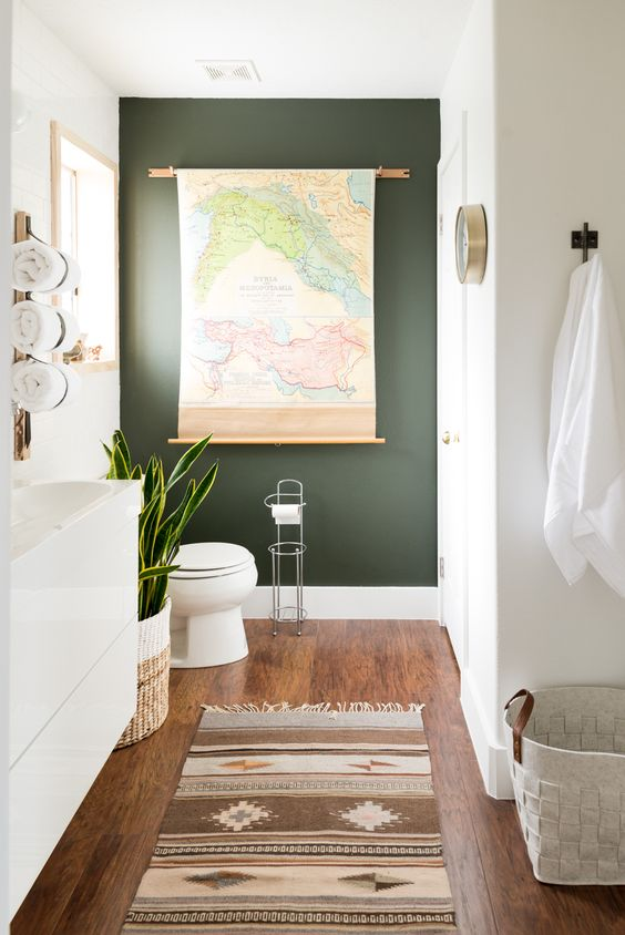 a black statement wall, baskets, a potted succulent and a map as an artwork