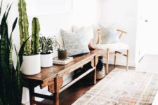 17 a boho rug, a vintage wooden bench, a chair, pillows and cacti and succulents in pots
