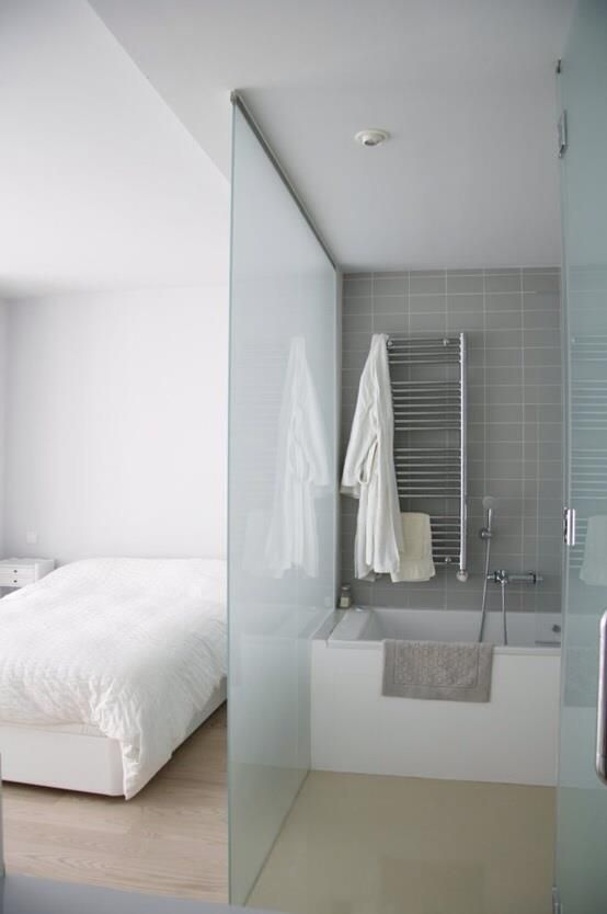 a frosted glass space divider is a great idea as it brings privacy yet doesn't separate too much