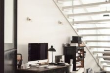 17 a large under the stairs home office nook is filled with light and features much storage – a cabinet and a desk