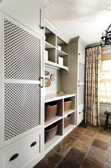 a traditional laundry with a washer and dryer behind lattice doors makes using them easy and you avoid the clutter