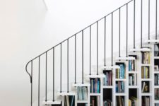 17 a white staircase that acts as a bookcase is all you need to save a lot of space in your home