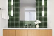 17 highlight the sink zone with a glossy green tile wall, it's a beautiful way to add color and a relaxing feel to the space
