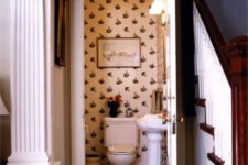 17 vintage printed wallpaper and aartworks make the powder room connected to the living room