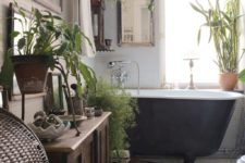 18 a boho bathroom as a greenery oasis with white tiles, wooden furniture and a woven chest for towels