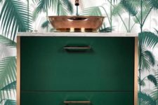 18 a chic dark green floatign vanity with copper touches and a palm leaf wall for en elegant look